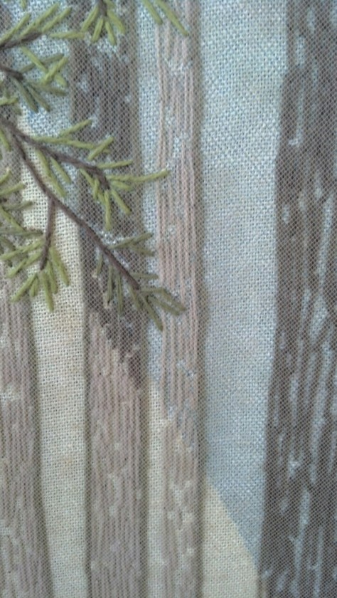 I've never seen anything like the tiny green netting that covers parts of the fabric to give the effect of shadows cast by taller trees.