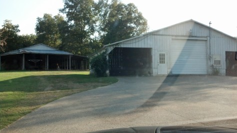 Hay barn (rear) and the white barn -- shop/man cave/husband's dream space.