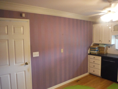 The back wall, resplendent in purple! Matte and gloss paint stripes; the paint was on top of -- are you ready for this -- wallpaper.